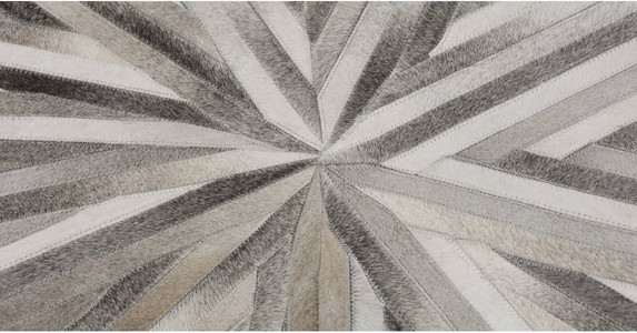 Halo Large Cowhide Circular Rug. Best rugs for living room. How to place a rug under a sofa. How to choose a rug for living room. Designer rugs collection. Designer round rugs. Best high street rugs. Rug trends 2018. Modern contemporary rugs. Luxury contemporary rugs. Modern rugs for living room