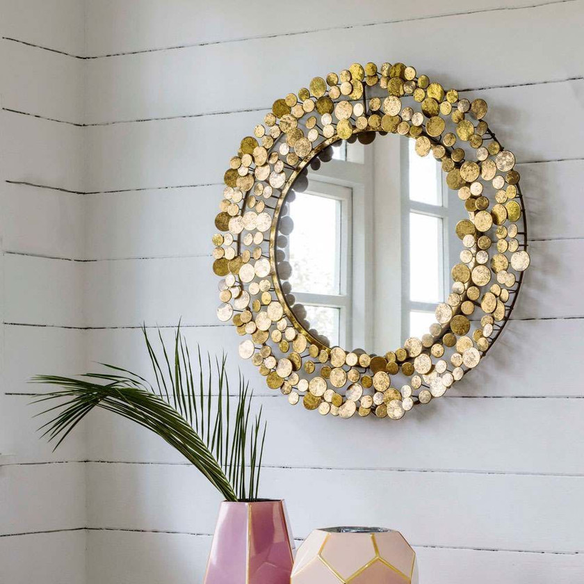 GOLD COIN MIRROR gold coin mirror offers the perfect focal point for an array of rooms. Individual distressed golden coins glitter and glimmer around this ornate circular glass