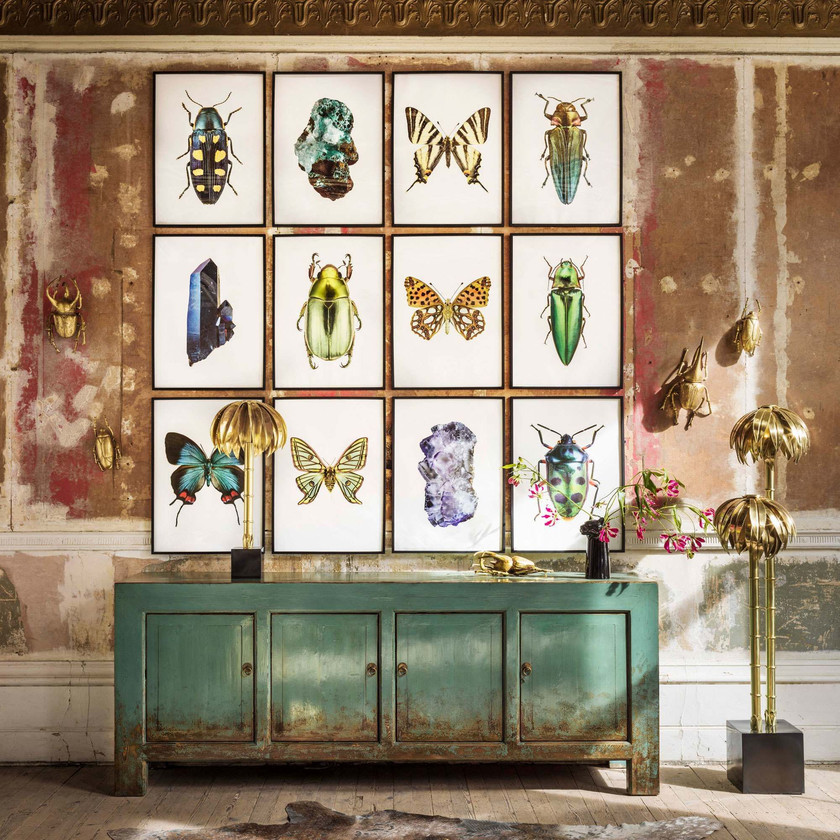 Lingbao Four Door Cabinet remains a storage solution with style. Handcrafted from pine wood, the distressed finish of the rich turquoise paint and circular iron handles will transform a space with vintage elegance