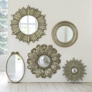 decorating with mirrors. round mirrors.