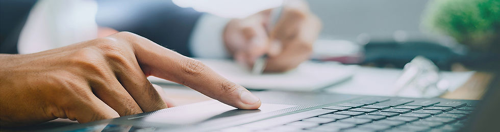 Photo depicting a Benelogic data audit specialist sitting at computer, analyzing data source files for issues that may impact the financial picture of a client's benefit plan.