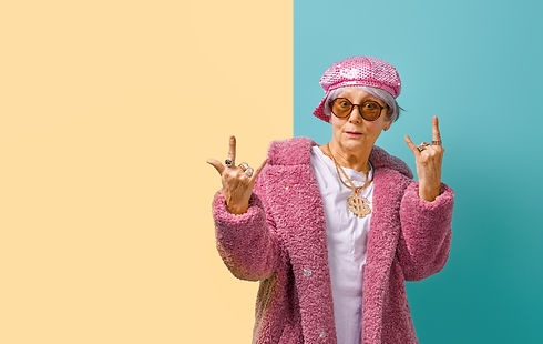 Portrait of funny senior woman on color