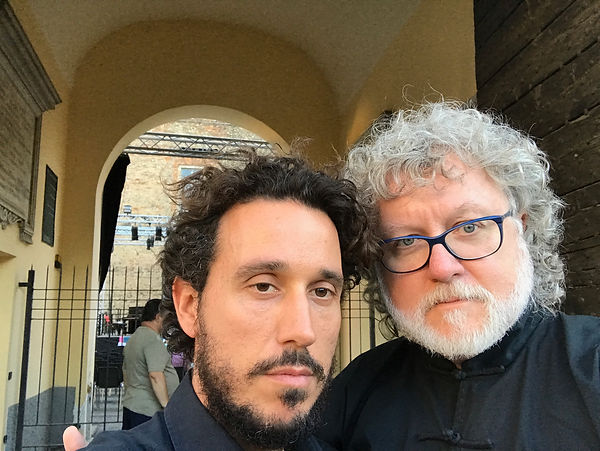 Cellist, Francesco Dessy and John Ratedge in a serious pose before the MUST CONCERT