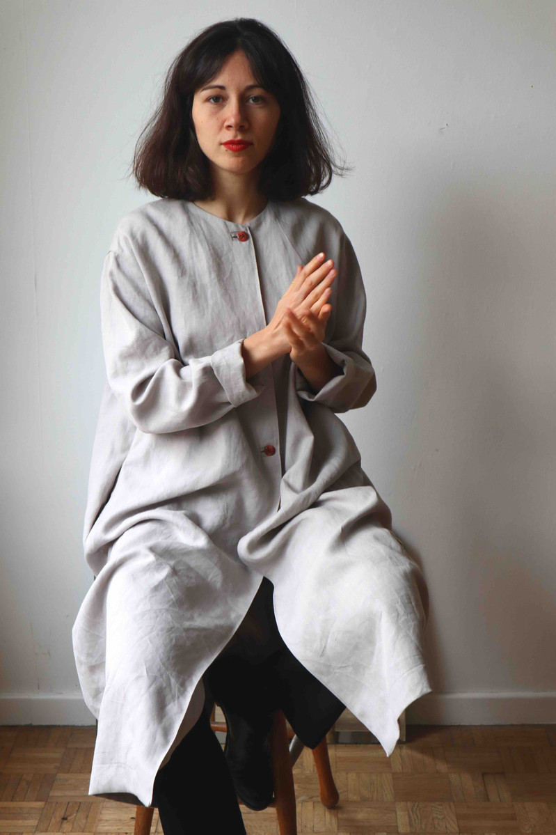 ORTU   Ortu is a long, wide coat with a round neck, side pockets and a front closure. Ideal for spring and autumn days.  Made of linen.  out of stock