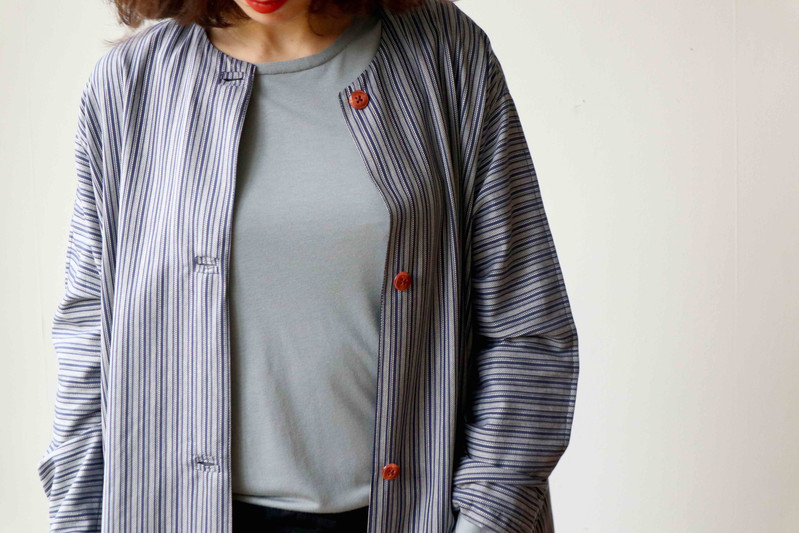 ORTU   Ortu is a long, wide coat with a round neck, side pockets and a front closure. Ideal for spring and autumn days.  Made of cotton.  size 3  This item is unique.  out of stock