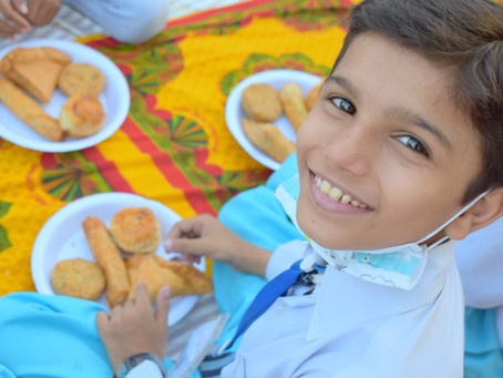 HOPE Hosts Outdoor Iftar for 260 Students in Zia Colony School