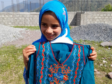 460 Kashmir Students Receive New Eid Clothes