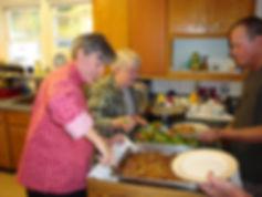 Jo Ann and Marg serving dinner