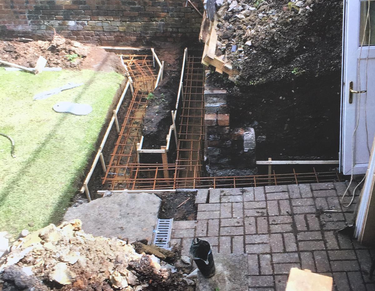 Retaining Wall with Curved Planter