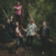 Bristol band Erotic Secrets of Pompeii standing in a woodland area with a lobster necklace