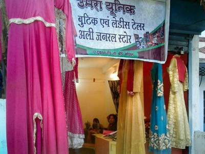 Dresses hang in Zahra's new storefront