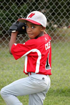 Young person playing baseball