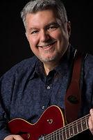 Tony Serzo holding a guitar.