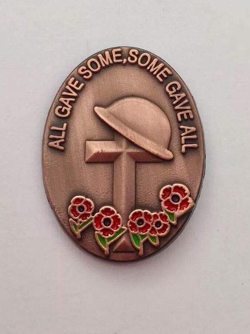Copper coloured oval lapel pin badge