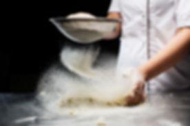 Woman hands kneading dough..jpg