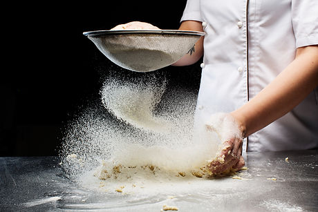 Woman hands kneading dough..jpg