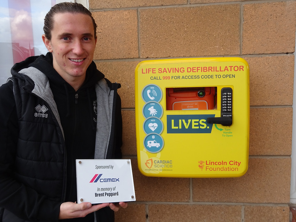 Lincoln City Player Aaron Lewis unveils plaque in memory of Brent Peppard