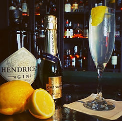 War Hawk Cocktail next to Hendrick's Gin and Chandon bottles