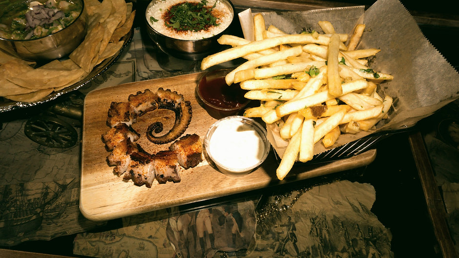 Butcher block with grilled octopus and garlic french fries