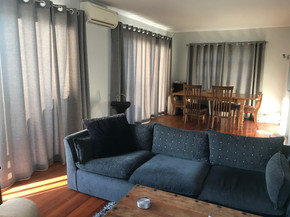 Grey curtains with silver rods