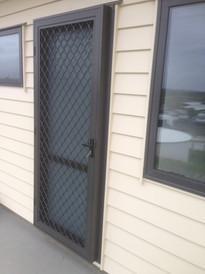 Hinged security door with addaptor