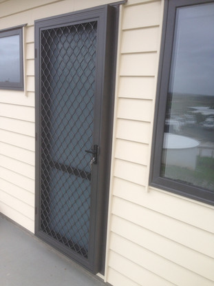 Hinged security door with adapter
