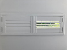 Hinged wooden shutters