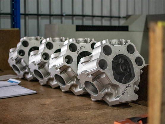 Raw cast engine cases to be machined.jpg