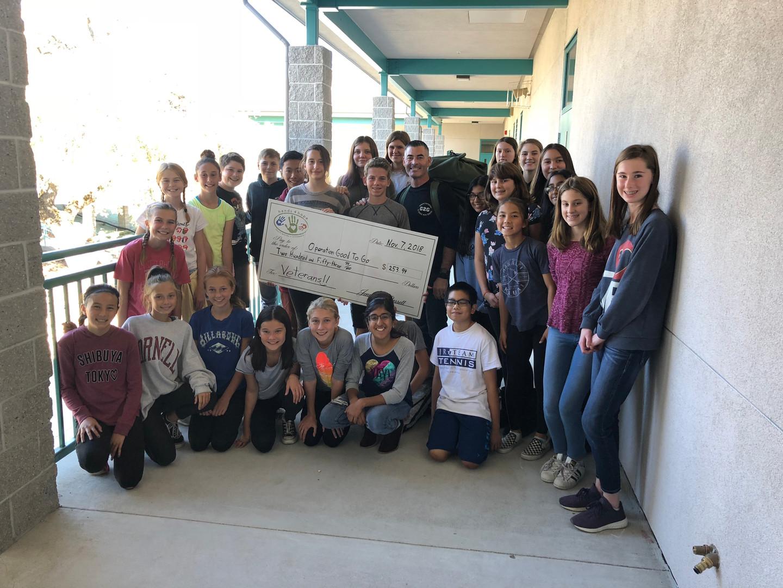 Marina Village Middle School   Providing Check to Homeless Veterans