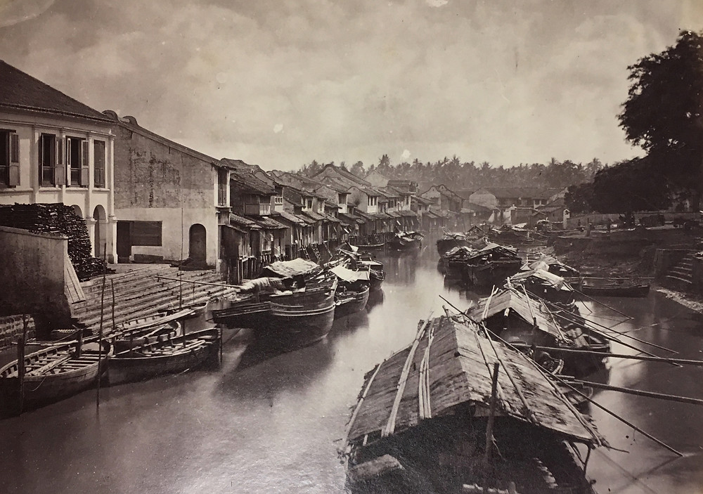 Black and white image of boats on a river.