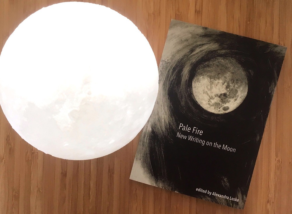 The anthology posing with my moon lamp.
