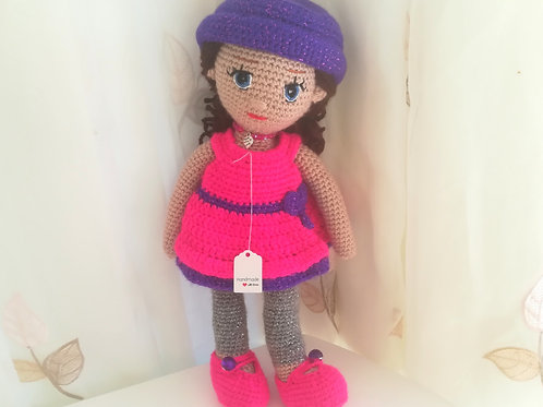 Glamorous Doll in fuchia & purple emsemble