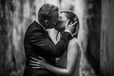 Picture of a wedding couple kissing in the rain, in Italy, Europe