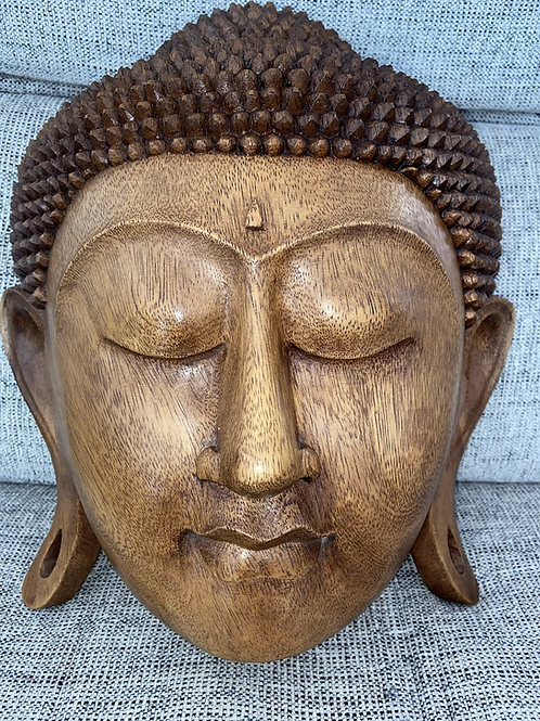 Beautiful solid wood carved Buddhist head wall hanging
