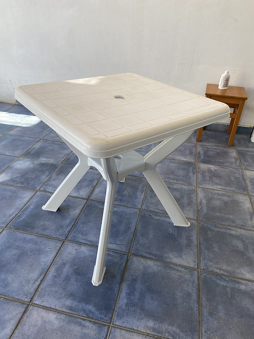 White plastic garden table with hole for parasol (not included)