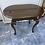 Thumbnail: Dark wood vintage oval table with turned legs