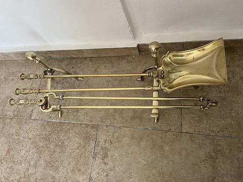 Vintage brass fireplace companion set including the firedogs