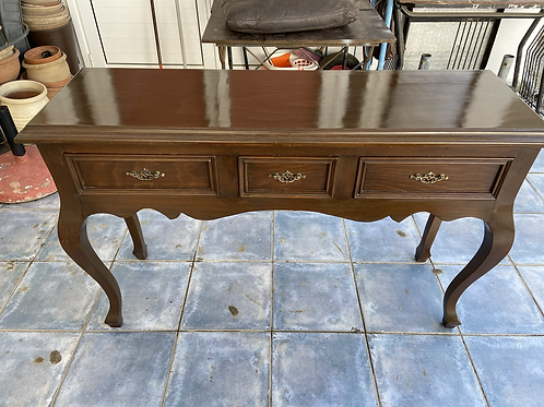 Antique dark wood console table with 3 drawers and turned legs