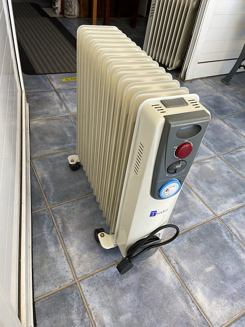 Large Tredia electric heater with thermostat and timer