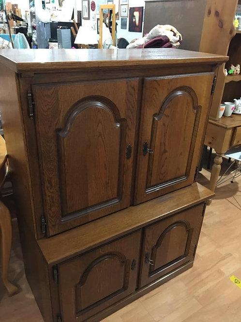 Tall English oak double cupboard