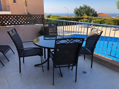 Outside glass table and four chairs in excellent quality and condition