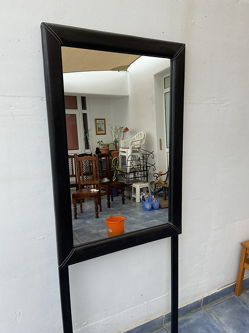 Black faux leather mirror with contrasting stitching