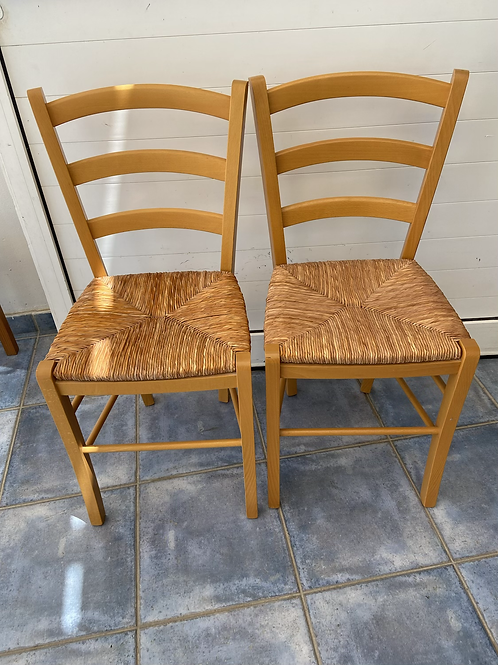 Pair of modern feel village chairs with rush seat pads