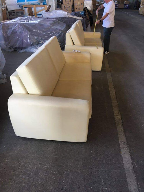 Two cream faux leather sofas