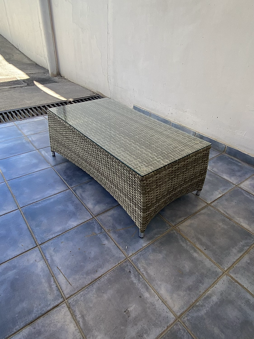 Almost new plastic rattan glass topped coffee table