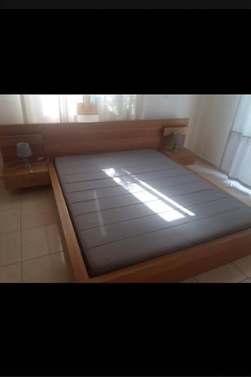 Double bed with built in headboard and bedsides