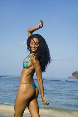 Happy woman in bikini on beach