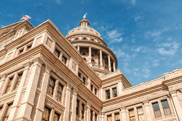 low-angle-shot-texas-capitol-building-blue-beautiful-sky-austin-city-texas.jpg
