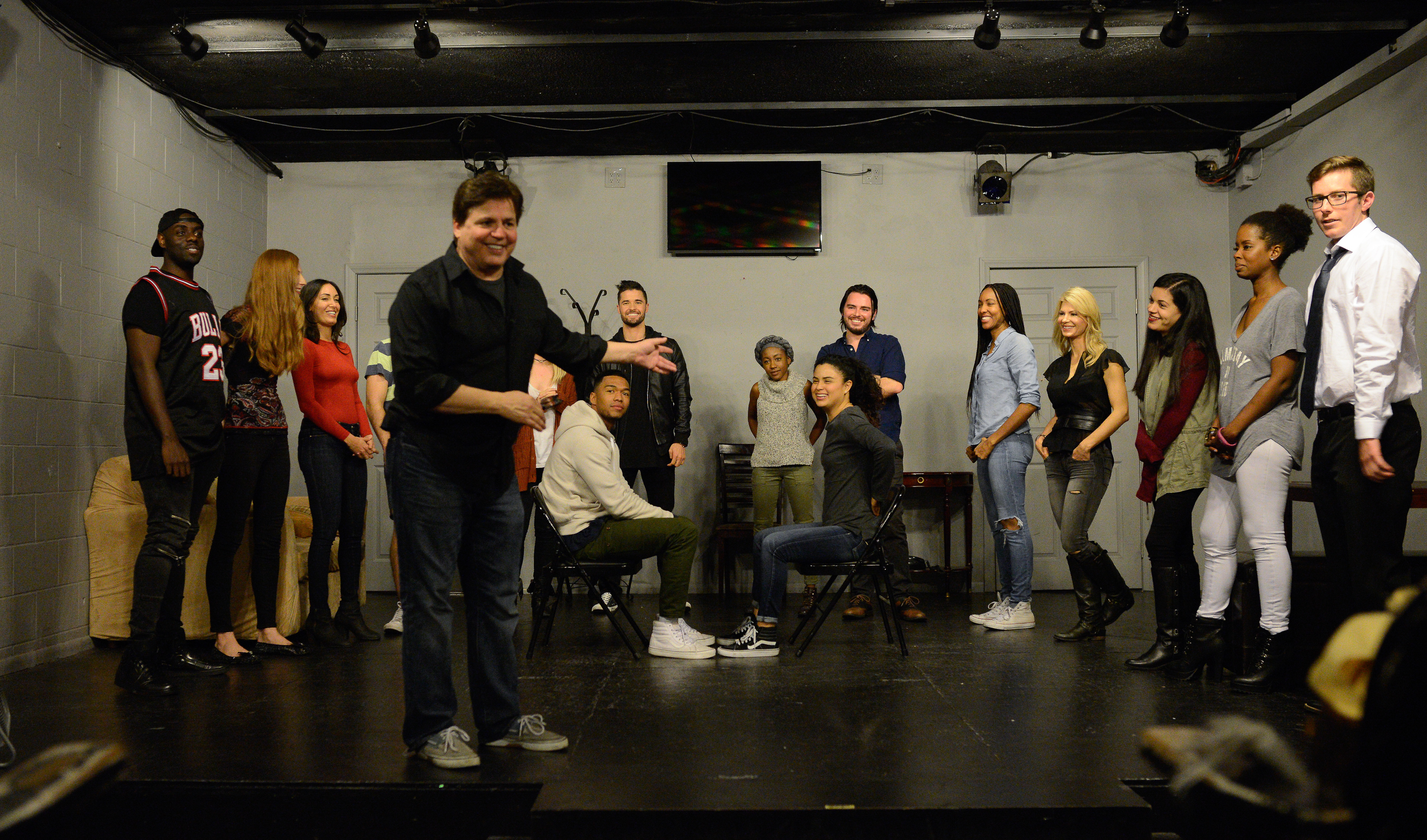 don in front of class students on stage meisner