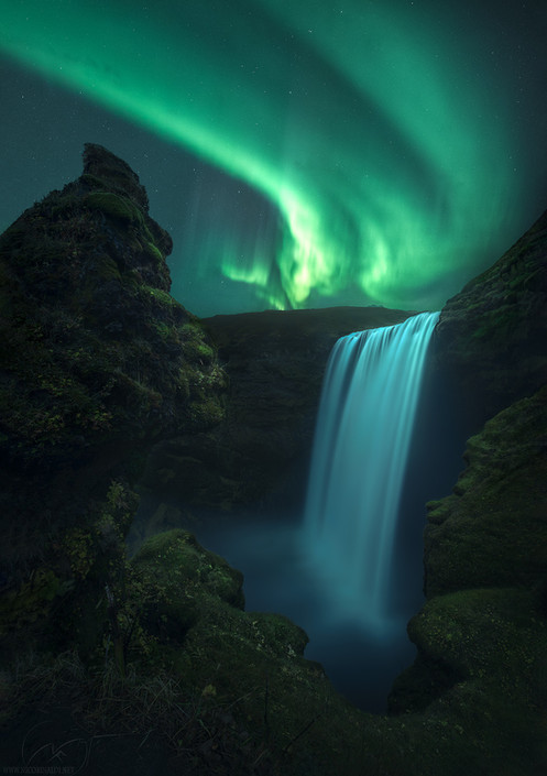 Skogafoss under the northern lights / Iceland